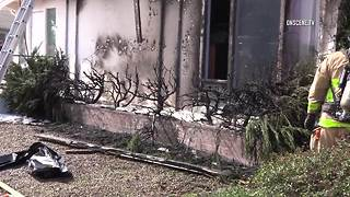 Man sets house on fire torching weeds - Video