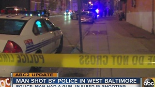 Man shot by police in Baltimore was armed with a gun, police say - Video