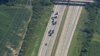 Police in standoff with gunman on I-75 in Monroe County after chase - Video