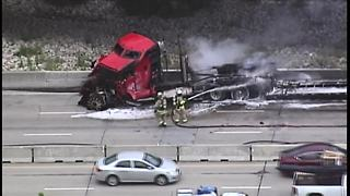 Crews clean up after fiery semi-truck crash on I-435 - Video