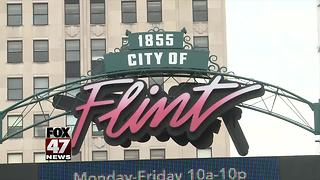 Flint residents react to charges in water crisis probe - Video