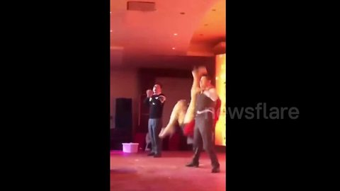 Senior executive in China drops performer on stage