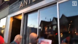 Restaurant Owner Sends Vegan Protesters Into A Frenzy With Epic Storefront Display - Video