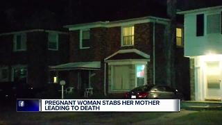 Pregnant woman stabs mother - Video