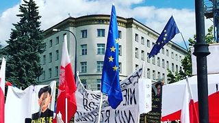 Warsaw Protesters Wave Flags, Chant Outside Parliament Building - Video