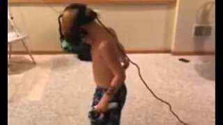 Kid hits the wall while playing VR game