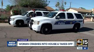 Woman crashes into Phoenix garage and flees - Video