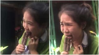 Girl cries after getting tongue stuck on a popsicle