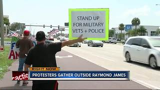 Protesters gather outside Raymond James - Video