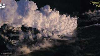 Smoke and Steam Towers Over Hawaiian Shore as Lava Streams Flow to the Ocean