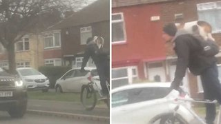 Are you fur'real? Hilarious moment cyclist gives dog a piggyback
