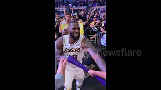Young fan freaks out when LeBron hands his arm sleeve to him - Video