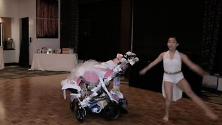 Daughter surprises mum with stunning dance duet with disabled sister, on her wedding day - Video