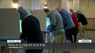 Voters turnout to the polls in Menomonee Falls