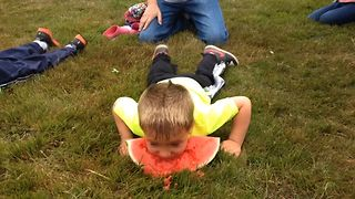 Watermelon Eating Kid Uses His Head