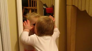 """Cute Little Girl Gives Herself Kisses In Mirror"""