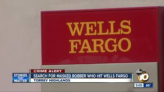 Masked man robs Wells Fargo branch - Video
