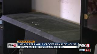 Man sleeps while crooks ransack his house - Video