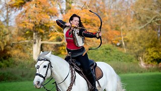 Real-Life Robin Hoods: Stunt Couple Fire Arrows From Horseback - Video