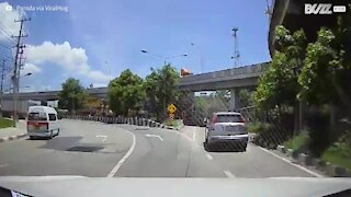 Motorcyclist collides with car but rides away unfazed