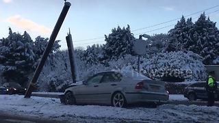 Car crashes into pole in Northern Ireland snow - Video