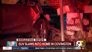 Driver crashes into Covington home