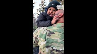 Military dad surprises his son playing at the park