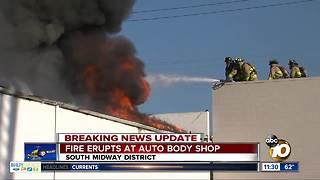 Fire destroys auto body shop near Lindbergh Field - Video
