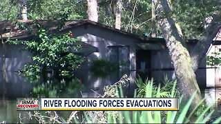 River flooding forces evacuations - Video