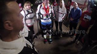 Simon Kindleysides becomes first paralysed man to complete London Marathon after 26-hour race - Video