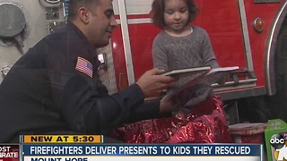 Firefighters deliver presents to kids they rescued - Video