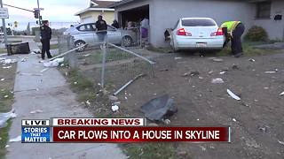 Car plows into Skyline-area home - Video