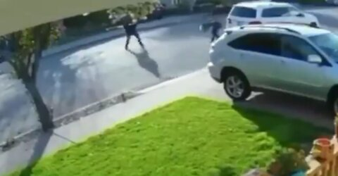 Thug Tries to Rob a Man at Gunpoint, Ends Up Getting the Hardest Bodyslam You've Ever Seen