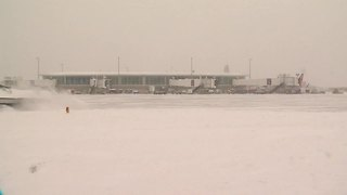 Airport crews working hard to clear runways - Video