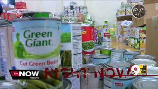 Harrison High School students collecting cans, coats