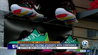 Firefighters helping students with new shoes for school