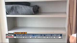 Teacher's bookshelf cleaned out during Hurricane - Video