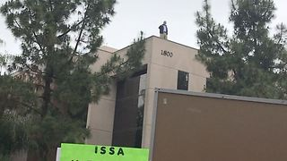 Congressman Darrell Issa Watches From Office Roof as Protesters Chant Below - Video