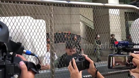 Hong Kong police erect barricades outside HQ as a major protest is held