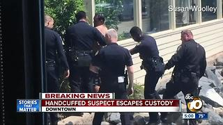 Handcuffed suspect escapes custody downtown - Video