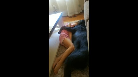 Rottweiler loves to cuddle with his human best friend