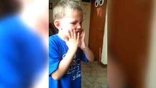 Cute Boy Reacts To Trying War Heads - Video