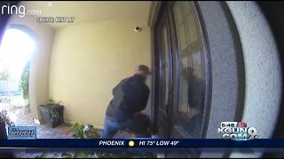 Thief violently tries to break into home - Video
