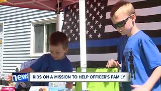 Boys open lemonade stand to help the family of a Cleveland police officer who died suddenly - Video