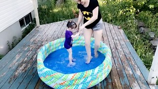 Cute Toddler Enjoys Summertime in Kiddie Pool - Video