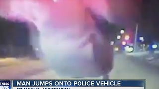 Man belly flops on police cruiser - Video