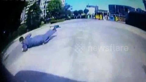 Car's near miss with skateboarder caught on dashcam