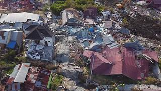Aerial footage shows houses flattened, piles of debris littered on earthquake-stricken Indonesia island - Video
