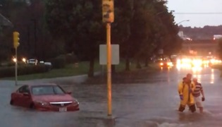 Roads Flooded in Madison, Wisconsin, After Heavy Rainfall - Video