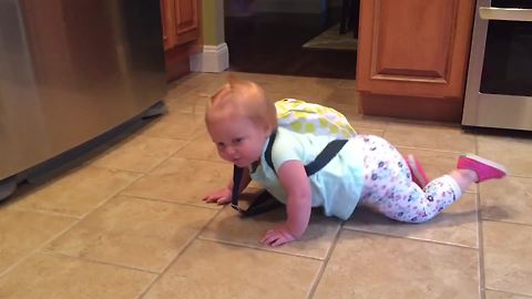 Cute Tot Girl With Heavy Backpack Struggles To Stand Up